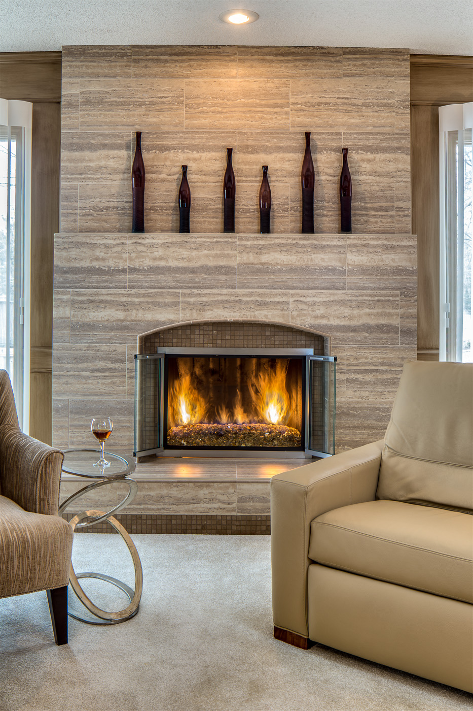 Stone tile fireplace remodel Design Connection Kansas City Interior Design
