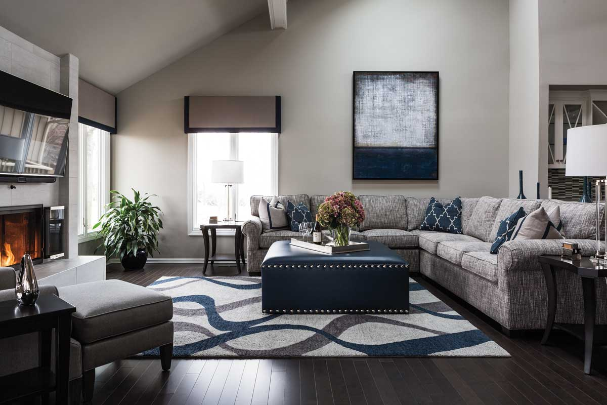 Modern, classic living room design with grey and blue accents throughout